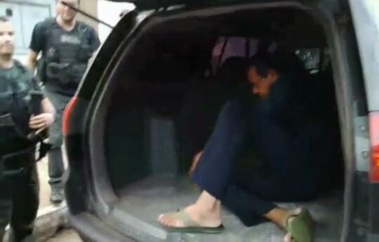 Ex-prefeito Lisboa sendo transportado em camburão